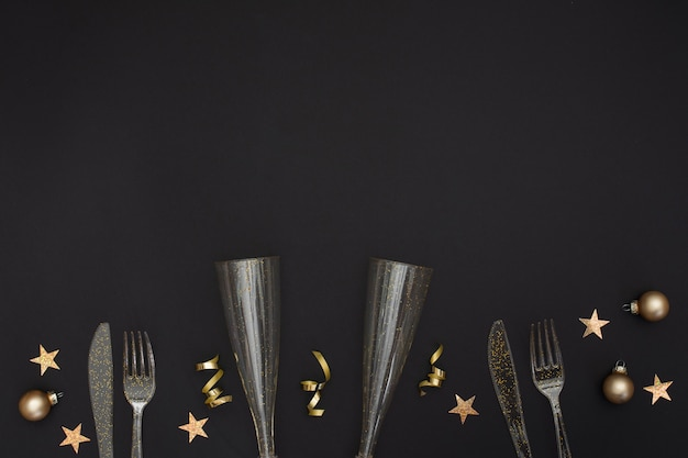 Festive glasses and cutlery with copy space
