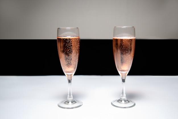 Festive glasses of pink champagne