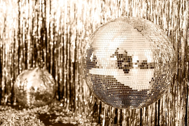 Festive gold background. disco ball on beige and set sail champagne