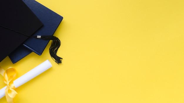 Festive graduation composition on yellow background