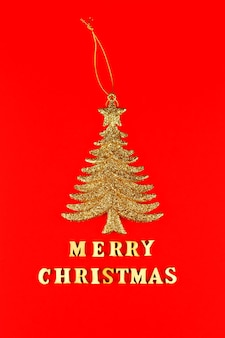 Festive greeting card. merry christmas lettering with golden glittering christmas tree.