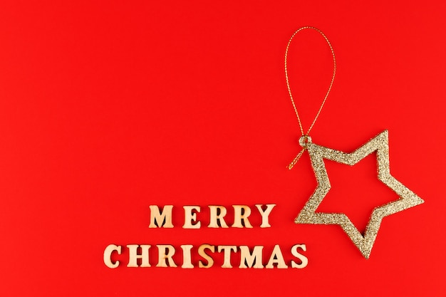 Festive greeting card. merry christmas lettering with golden glittering star.