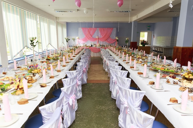 Festive hall with a table laid for the wedding celebration