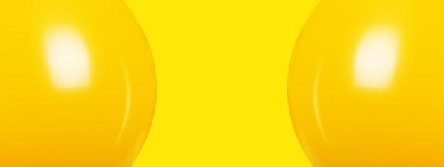 黄色い空間の上のお祝いの膨脹可能な風船