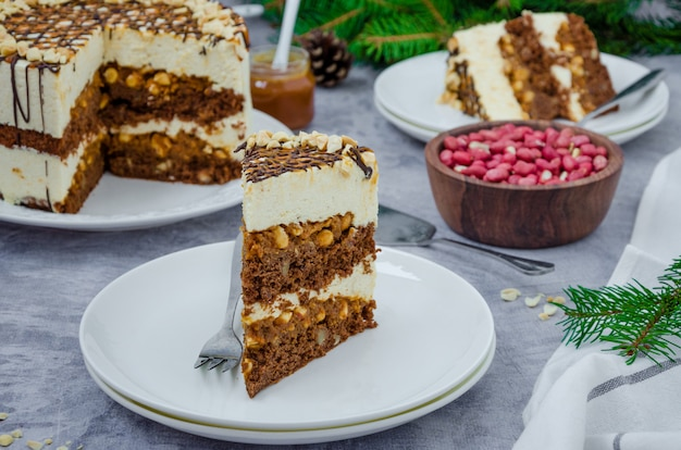Festive layer cake with chocolate sponge cake, nougat, salted caramel and peanuts.