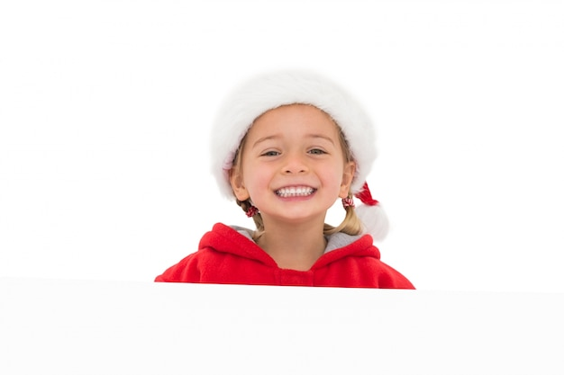 Festive little girl showing poster