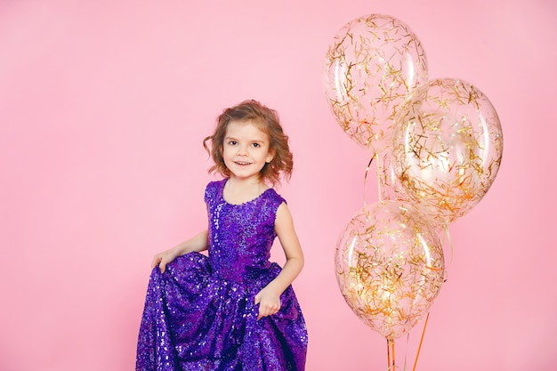 Festive little girl with balloons