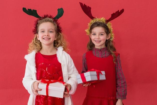 Festive little girls holding gifts