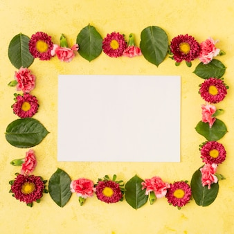 Festive natural flower frame composition and copy space white card