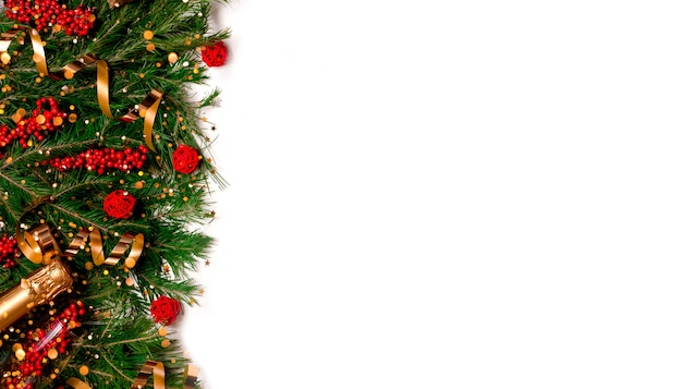 Festive new year background. christmas and new year decorations fir tree and bokeh lights. top horizontal view copyspace