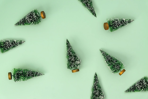 Festive new year background with scattered christmas trees. pattern design for backdrop. minimal style.