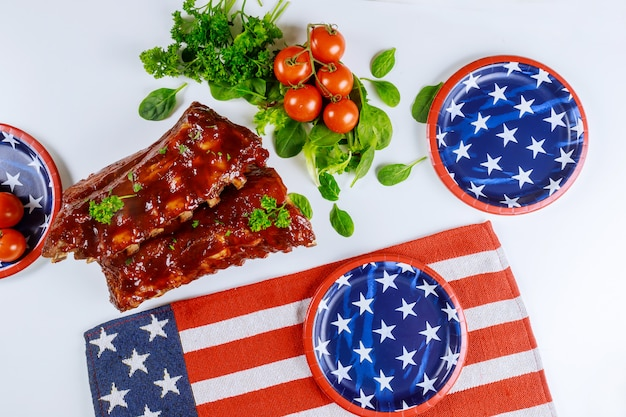 Festive party table with ribs and vegetable for american holiday.