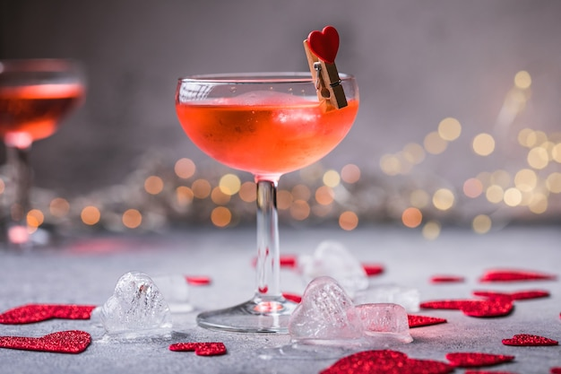 Festive pink cocktail with champagne or prosecco  for st. valentine's day. couple of glasses