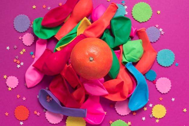 Festive poster balloons orange confetti carnival background ultraviolet.