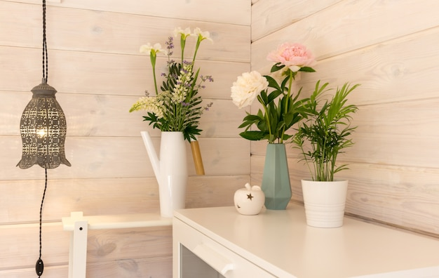 Festive romantic bouquets of white and pink peonies on a white wooden wall background, scandinavian style. wedding, valentines day background