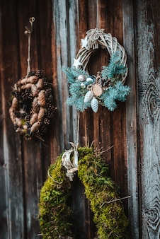 Festive rustic wreath of cones on a dark brown wooden background. the concept of the christmas holiday and new year.