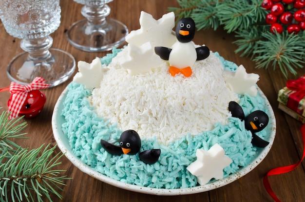 Festive salad penguins on an ice floe
