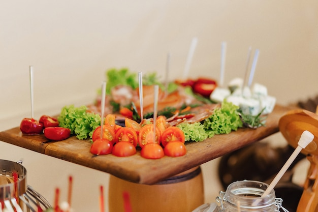 Festive salty buffet, fish, meat, chips, cheese balls and other specialties for celebrating weddings and other events