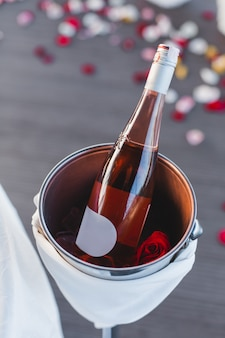 Festive served table for a romantic dinner with wine bottle