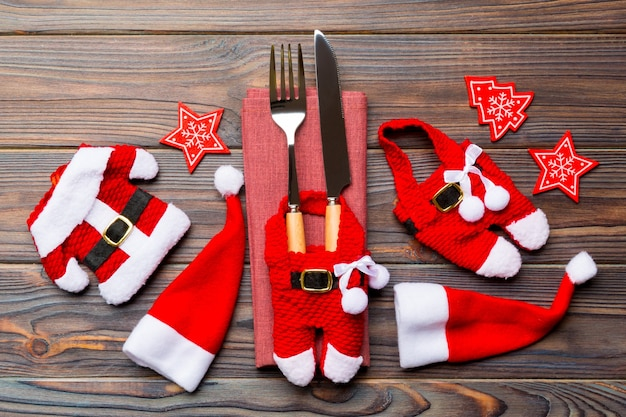 Festive set of fork and knife on wooden surface