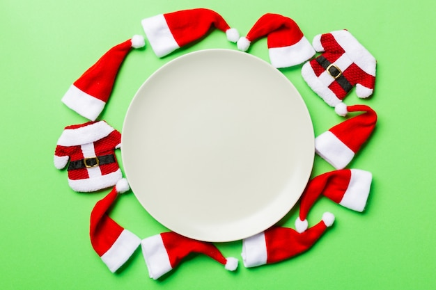 Festive set of plate decorated with santa claus hat on green