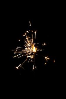 Festive shiny sparkler in the dark