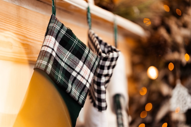 Festive stockings hanging on fireplace at christmas