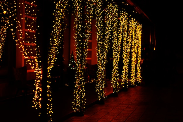 Festive street lighting garland curtain in yellow color
