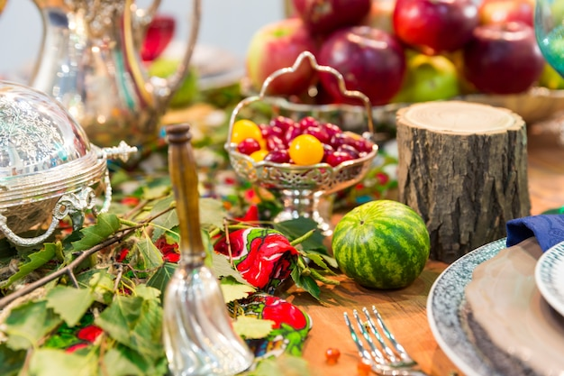 Festive table decorated with fruits closeup, nobody. holiday celebration