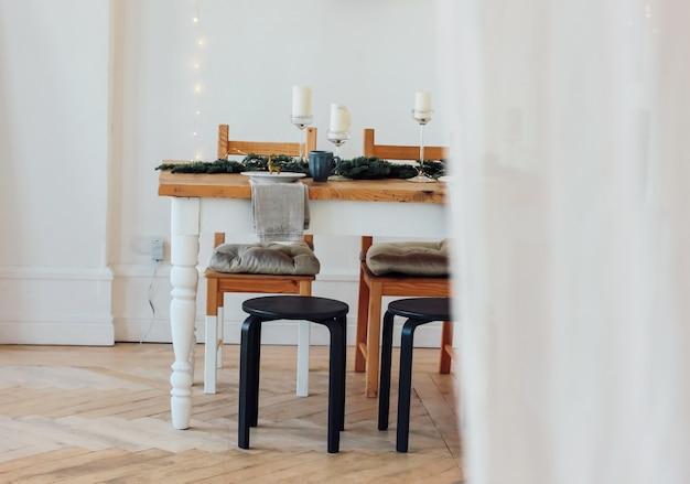 Festive table, minimalistic christmas decor. scandinavian interi