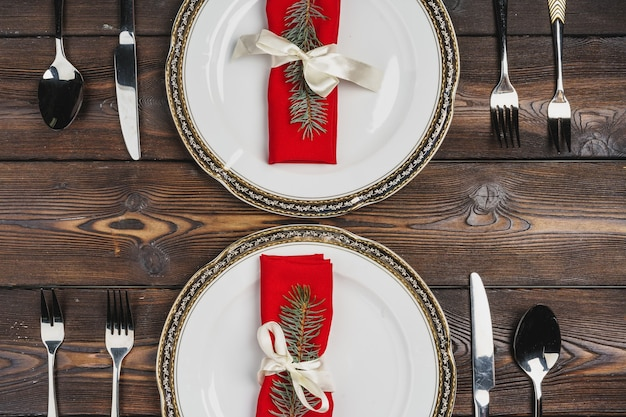 Festive table setting for christmas dinner top view