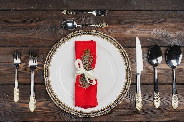 Festive table setting for christmas dinner, top view