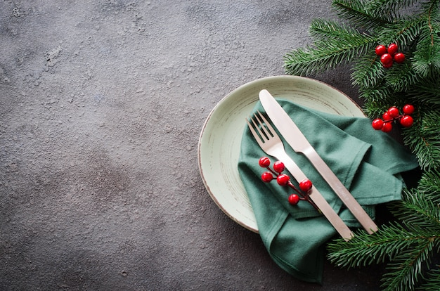 Festive table setting for christmas or new year dinner.