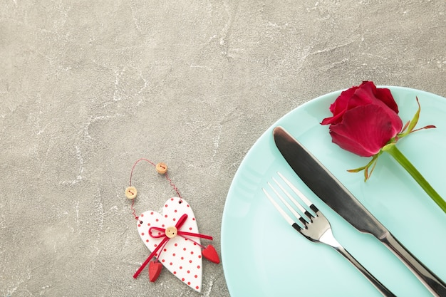 Festive table setting for valentines day on grey