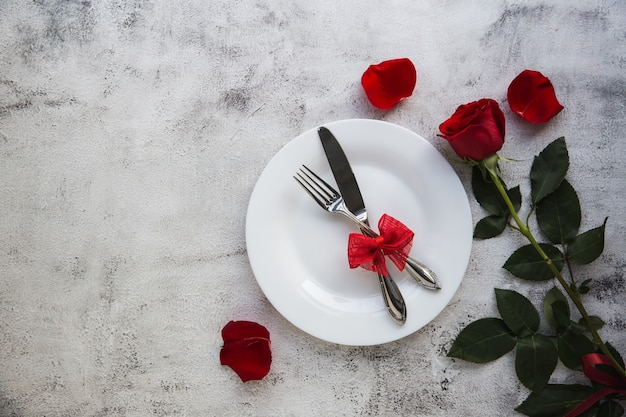Festive table setting with red roses for valentines day.