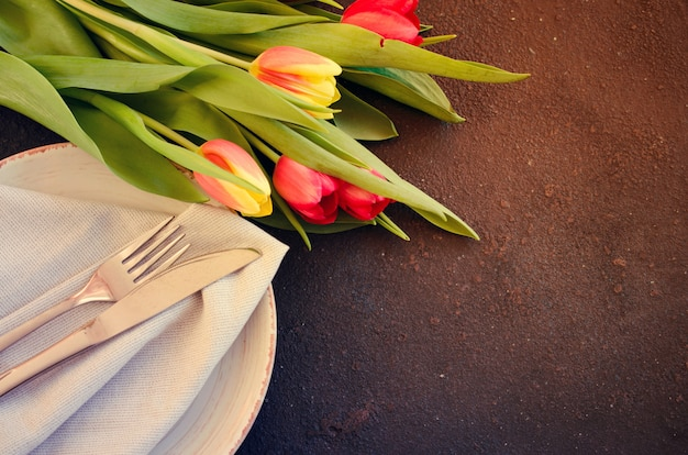Festive table setting with tulips for birthday
