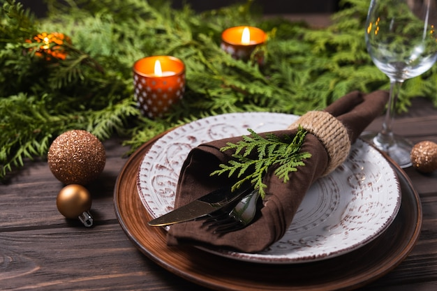 Festive table setting with winter decor christmas or new year holiday background