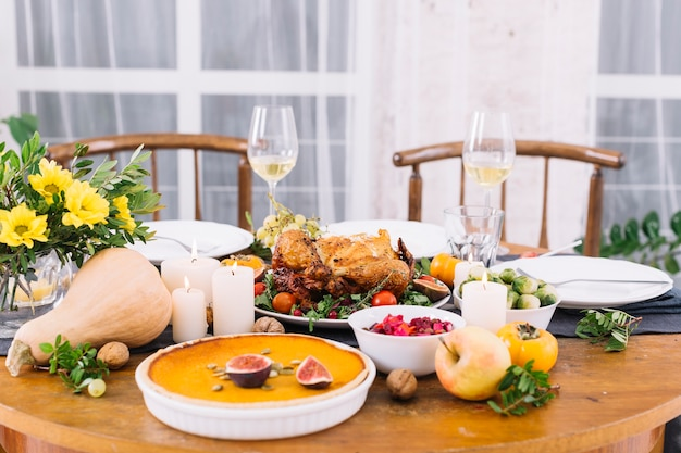 Festive table with baked chicken