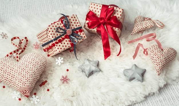 Festive wall with a christmas gift and christmas decor items .