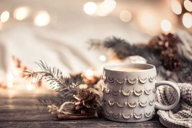 Festive wall with cup on wooden wall with lights.