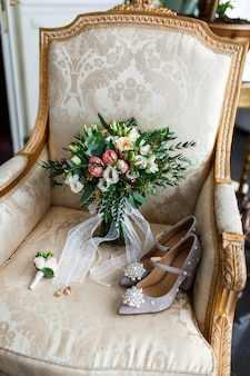 Festive wedding composition on elegant armchair