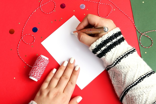 Festive woman manicure in white colorhand holding golden ballcozy atmosphere