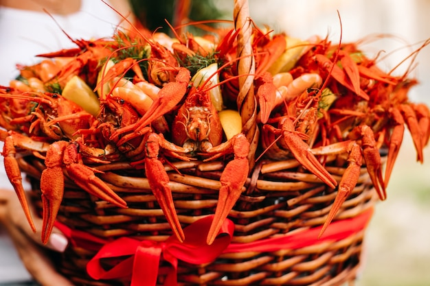 Festive woven gift basket for a man with crayfish and lemons