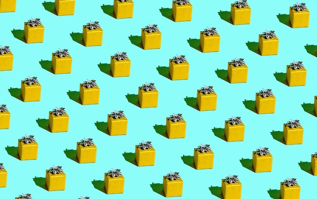 Festive yellow gift on a blue background seamless pattern