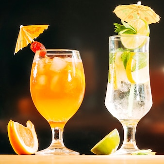 Festively decorated glasses with juicy drink sliced lime and orange