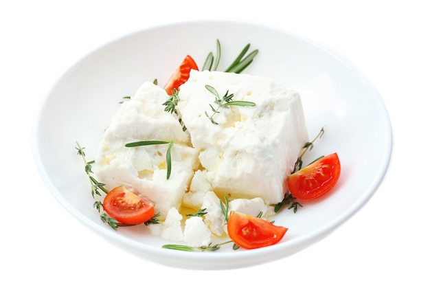 Feta cheese isolated on white surface