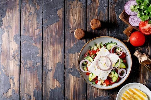 Feta cheese salad in ceramic bowl