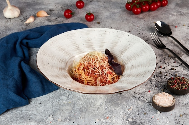 Fettuccine pasta with bolognese sauce, gray background