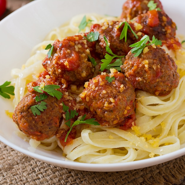 Fettuccine pasta with meatballs in tomato sauce