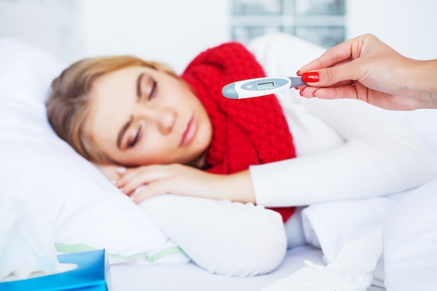Fever and cold, portrait of beautiful woman caught flu